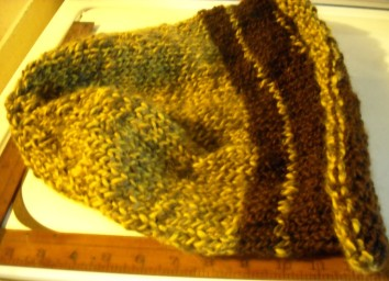 gold and light brown(mohair &wool) with dark wool band to felt